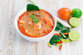Tom Yam Kung, Spicy Thai food on wood background - PhotoDune Item for Sale