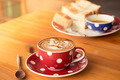 A cup of coffee in a red cup on wooden background - PhotoDune Item for Sale