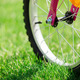 Children's bicycle on green grass, close up photo - PhotoDune Item for Sale
