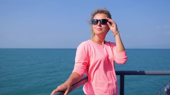 Attractive Female On a Yacht At Summer Day In Sea
