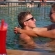 Couple Relaxing In Sunny Swimming Pool - VideoHive Item for Sale
