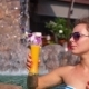 Young Woman Drinking Fruit Juice In Swimming Pool - VideoHive Item for Sale
