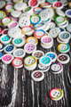 Multi colored buttons on a wooden background - PhotoDune Item for Sale