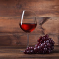 Red wine in glass with grape on wood - PhotoDune Item for Sale