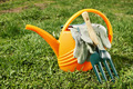 Watering can and gardening tools on green grass - PhotoDune Item for Sale