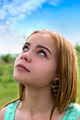 Young sensual blonde staring at the sky outdoors - PhotoDune Item for Sale