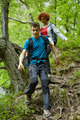 Family of hikers walking on a mountain trail - PhotoDune Item for Sale