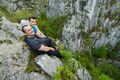 Father and son sitting on the edge of a cliff - PhotoDune Item for Sale