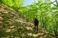 Teenager hiker walking on a mountain trail - PhotoDune Item for Sale