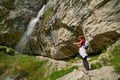 Woman taking photos near the waterfall - PhotoDune Item for Sale