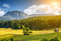 Colorful Alpine scenery with sun setting down