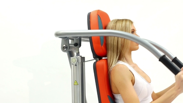 Blonde Woman On Hydraulic Exerciser