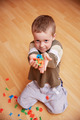 Little boy playing with alphabet letters on the floor. - PhotoDune Item for Sale