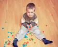 Little toddler playing with alphabet letters on the floor. - PhotoDune Item for Sale