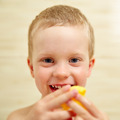 Little boy playing in bathroom and smiling. - PhotoDune Item for Sale