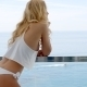 Blond Woman Wearing White Bikini And Silky Top - VideoHive Item for Sale