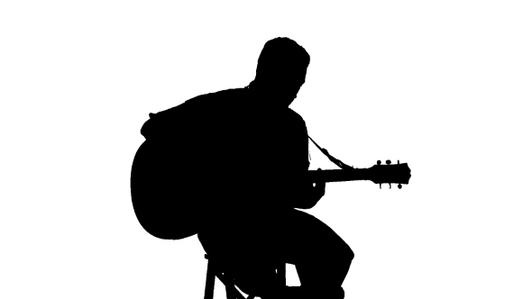 Silhouette Of Sitting Man Playing The Guitar On a