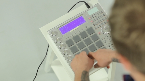 DJ Mixing Music On a Panel Of The Midi