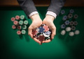 Casino playes holding a handful of chips - PhotoDune Item for Sale