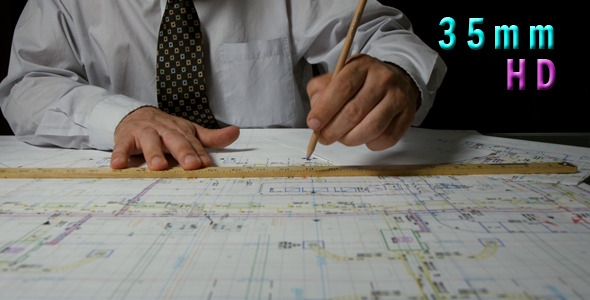 Architect Draws a Draft Using a Ruler