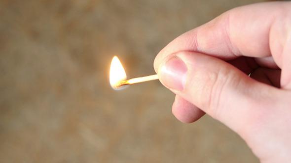 Man Lights A Match
