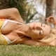 Woman Wearing Sun Dress Lying On Side On Grass - VideoHive Item for Sale