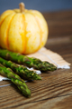 Asparagus on a mat with a pumpkin. - PhotoDune Item for Sale