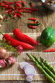 Asparagus on a mat with a red pepper. - PhotoDune Item for Sale