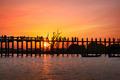 Silhouettes at U Bein teak bridge at sunset. Myanmar (Burma)