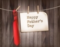 Happy Father's Day background with a red tie on a wooden backdrop.  - PhotoDune Item for Sale