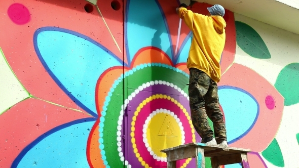 Creative Art Man Painting Graffiti On Wall