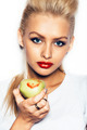 beautiful young woman holding an apple - PhotoDune Item for Sale