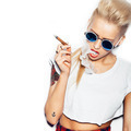 Sexy blonde woman in sunglasses smoking cigar - PhotoDune Item for Sale