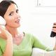 Beautiful caucasian female listening to music - PhotoDune Item for Sale