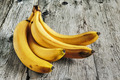 Ripe bananas on old wooden boards - PhotoDune Item for Sale