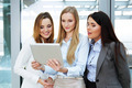 Three businesswomen looking at a tablet - PhotoDune Item for Sale