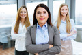 Three businesswoman standing in an office - PhotoDune Item for Sale