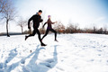 Couple running on snow - PhotoDune Item for Sale