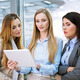 Three businesswomen looking at a digital tablet - PhotoDune Item for Sale