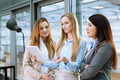 Young female entrepreneurs standing and discussing - PhotoDune Item for Sale