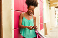 African American Girl Shopping And Text Messaging On Phone - PhotoDune Item for Sale