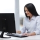 Smiling Businesswoman With Computer In Office - VideoHive Item for Sale