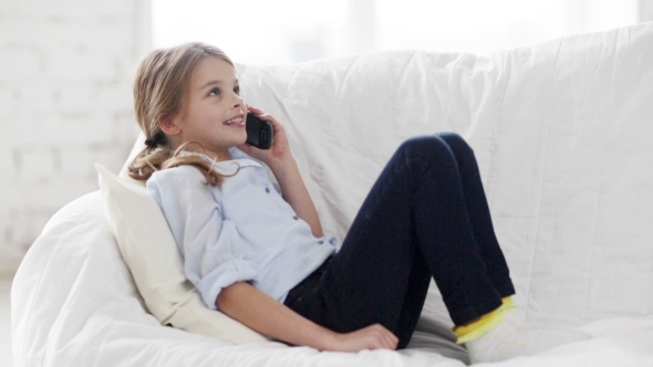 Happy Girl Calling On Smartphone At Home