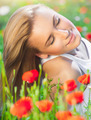 Beautiful woman on poppy flower field - PhotoDune Item for Sale