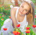 Beautiful girl on poppy flower field - PhotoDune Item for Sale
