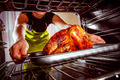 Cooking chicken in the oven at home. - PhotoDune Item for Sale