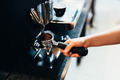 Barista grinding coffee - PhotoDune Item for Sale