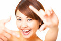 happy young Woman showing frame finger sign - PhotoDune Item for Sale