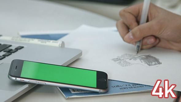Girl Drawing near Green Screen Smartphone