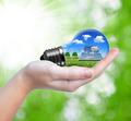 Hand holding eco light bulb - PhotoDune Item for Sale